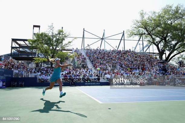 CoCo Vandeweghe of the United States returns a shot against Alison Riske of the United States during their first round Women's Singles match on Day...