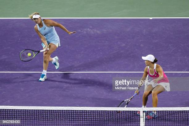 CoCo Vandeweghe of the United States returns a shot against Ekaterina Makarova and Elena Vesnina of Russia while playing with Ashleigh Barty of...