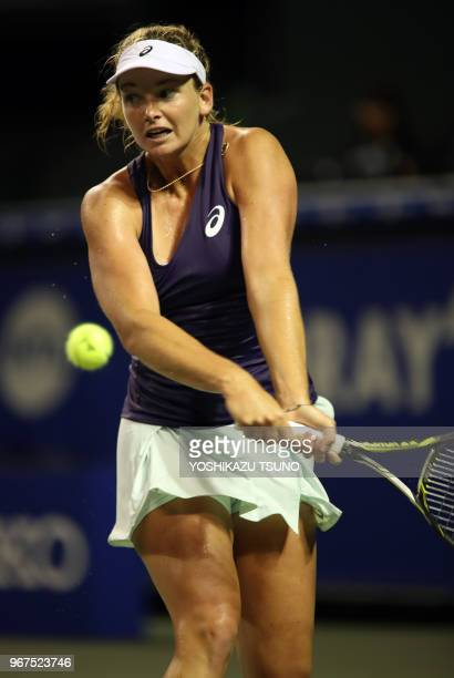 Coco Vandeweghe of the United States returns the ball during the first round of the Toray Pan Pacific Open tennis championships in Tokyo on September...