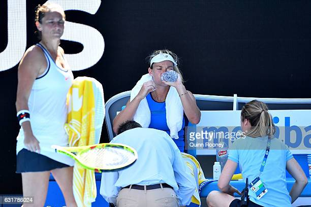 Coco Vandeweghe of the United States seeks medical attention due to the heat in her first round match against Roberta Vinci of Italy on day one of...