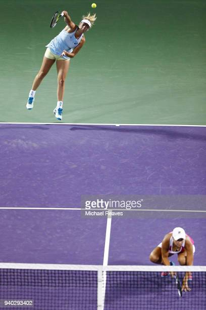 CoCo Vandeweghe of the United States serves against Ekaterina Makarova and Elena Vesnina of Russia while playing with Ashleigh Barty of Australia...