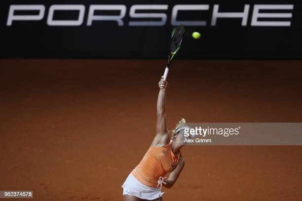 CoCo Vandeweghe of the United States serves the ball to Caroline Garcia of France during day 6 of the Porsche Tennis Grand Prix at PorscheArena on...