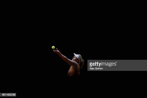 CoCo Vandeweghe of the United States serves the ball to Laura Siegemund of Germany during day 4 of the Porsche Tennis Grand Prix at PorscheArena on...