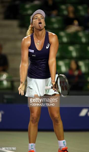 Coco Vandeweghe of the United States sticks her tongue as she lost a key point during the first round of the Toray Pan Pacific Open tennis...