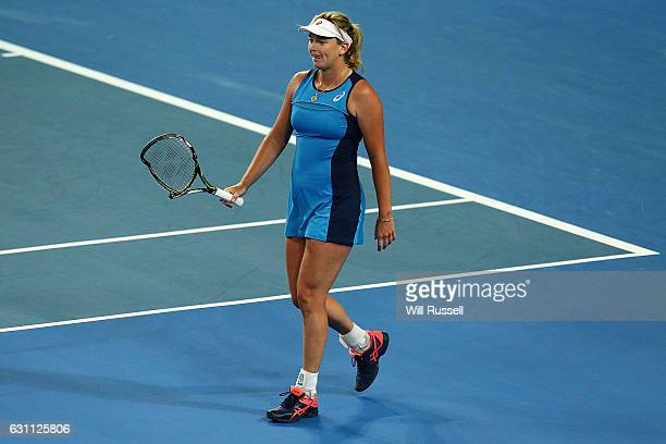Coco Vandeweghe of the United States walks off court with her damaged racquet in the womens singles match against Kristina Mladenovic of France...
