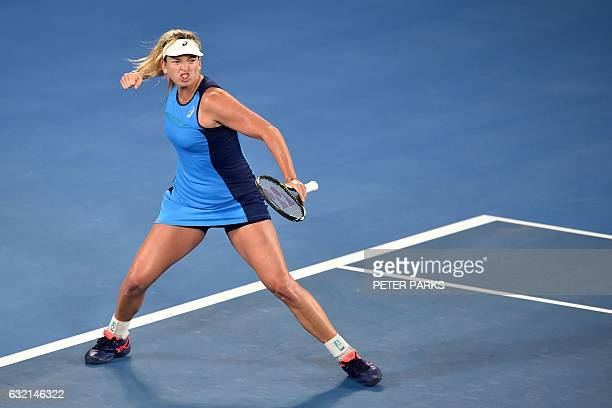 TOPSHOT Coco Vandeweghe of the US celebrates her victory against Canada's Eugenie Bouchard during their women's singles third round match on day five...