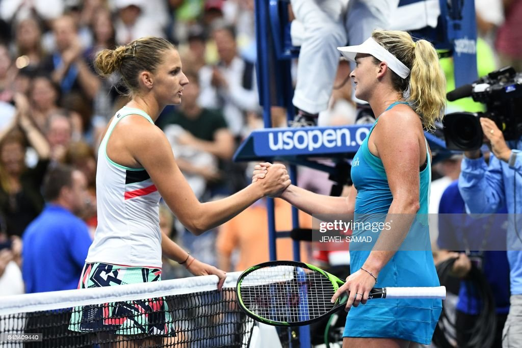 CoCo Vandeweghe (R) of the US shakes hands with Czech Republic's Karolina Pliskova after winning their 2017 US Open Women's Singles Quarterfinal match at the USTA Billie Jean King National Tennis Center in New York on September 6, 2017. American 20th seed CoCo Vandeweghe reached the US Open semi-finals Wednesday with a 7-6 (7/4), 6-3 win over Karolina Pliskova as the Czech player lost her world number one ranking to Garbine Muguruza. / AFP PHOTO / Jewel SAMAD