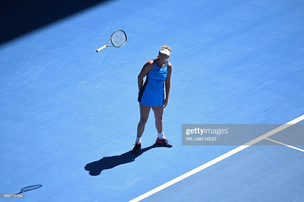 TOPSHOT - Coco Vandeweghe of the US throws her racquet while playing against Venus Williams of the US during their women's singles semi-final match on day 11 of the Australian Open tennis tournament in Melbourne on January 26, 2017. / AFP / WILLIAM