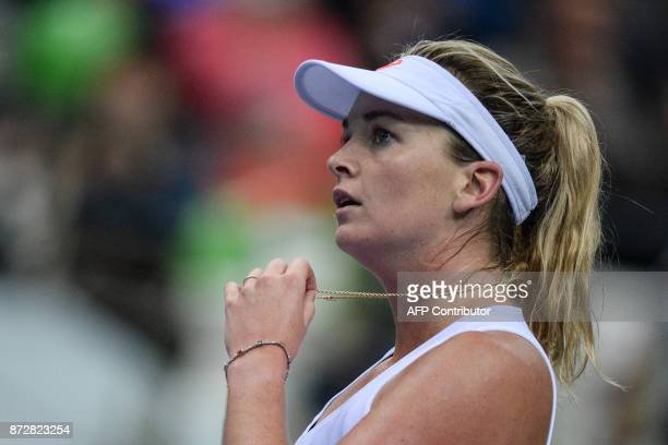 US Coco Vandeweghe reacts as she plays against Belarus' Aliaksandra Sasnovich on November 11 2017 in Minsk during their Fed Cup final tennis match...