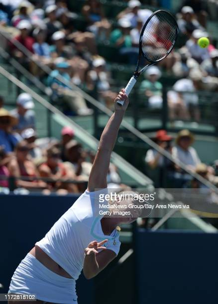 Coco Vandeweghe serves in the first set of her finals match against Serena Williams for the Bank of the West Classic tennis tournament at Taube...