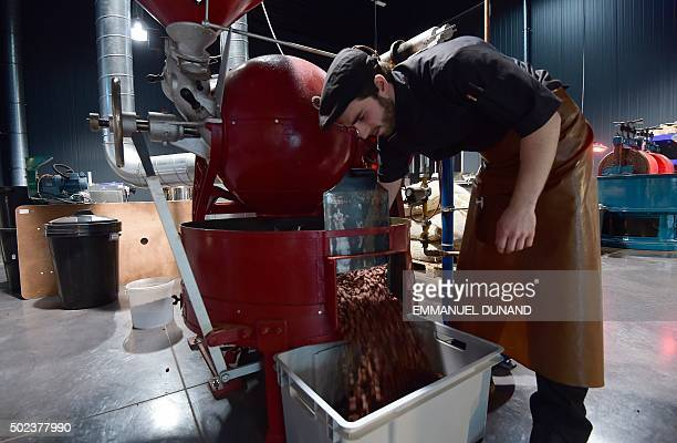 A cocoa bean roaster works at the Benoit Nihant's chocolate factory in Awans on December 11 2015 In a country where chocolate is a national pastime...