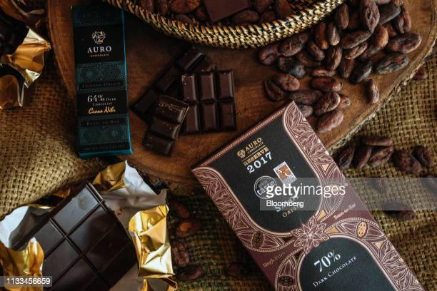 Cocoa beans and chocolate bars sit on display at the Auro Chocolate production facility in Calamba, Laguna province, Philippines, on Monday, Feb. 11,...