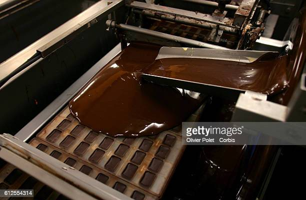 Cocoa beans are transformed into liquid chocolate at chocolate manufacturer Pierre Marcolini's factory The liquified chocolate will become a coating...