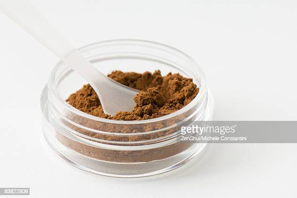 Cocoa powder in small container