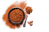 Cocoa powder with cocoa beans shot from above on white background