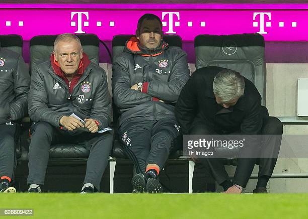 Cocoach Hermann Gerland of Bayern Muenchen Cocoach Paul Clement of Bayern Muenchen and coach Carlo Ancelotti of Bayern Muenchen sits on the bench...