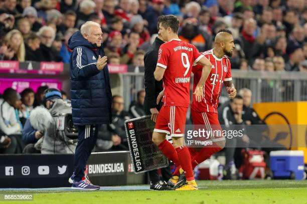Cocoach Hermann Gerland of Muenchen Arturo Erasmo Vidal of Muenchen and Robert Lewandowski of Muenchen gesture during the Bundesliga match between FC...