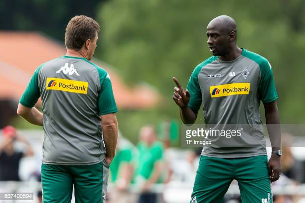 Cocoach Otto Addoof Borussia Moenchengladbach speak with Head coach Dieter Hecking of Borussia Moenchengladbach during a training session at the...
