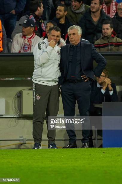 Cocoach Willy Sagnol of Bayern Muenchen speak with Head coach Carlo Ancelotti of Bayern Muenchen during the UEFA Champions League group B match...
