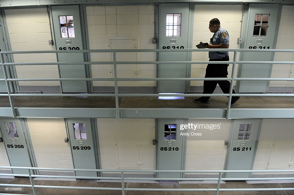 CANON CITY, CO--Colorado Department of Corrections Correctional Officer, David Aldana, walks along the third level of cell house #8 at the Fremont Correctional Facility during a formal count at the prison in Canon City Friday afternoon. Andy Cross, The De : News Photo