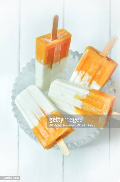 Coconut and mango popsicles