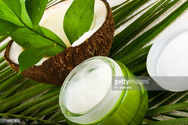 Coconut body care cosmetics in green container and white top