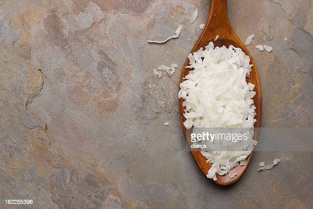 Coconut Flakes in Wooden Spoon