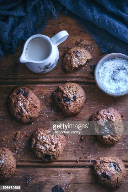 Coconut flour chocolate chip cookies on a rustic wooden table