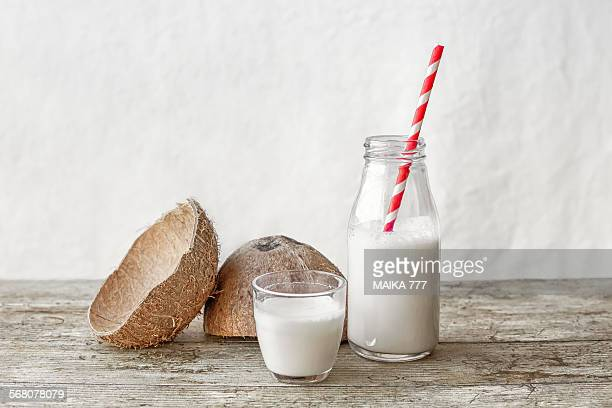 Coconut milk and coconut fruit cut in half