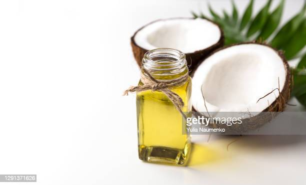 coconut oil and fresh coconut on white background. - coconut oil stock pictures, royalty-free photos & images