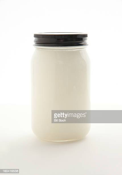 Coconut oil in a jar on white