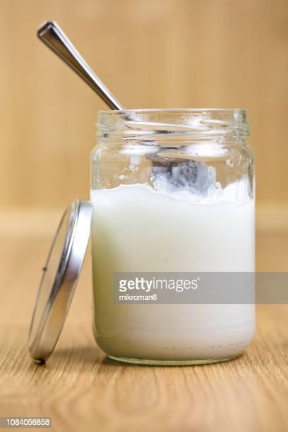 coconut oil in jar with spoon - coconut oil stock pictures, royalty-free photos & images