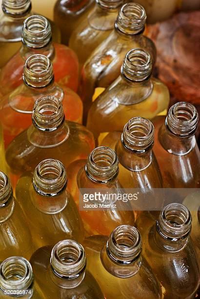 Coconut oil in old rum bottles