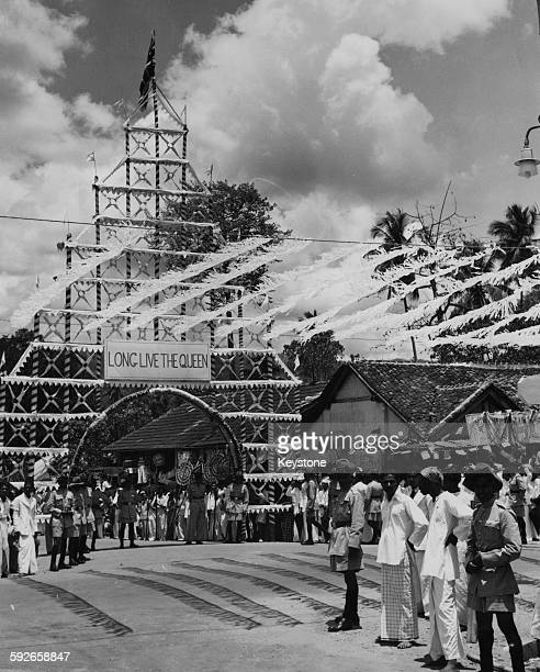 Coconut palm leaves were used to decorate the streets of the small town of Matale ready for the visit of Queen Elizabeth II on her Royal Tour Ceylon...