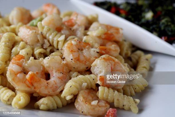Coconut pasta with shrimp at Obosa Nigerian restaurant in the Roslindale neighborhood of Boston on July 03, 2020.