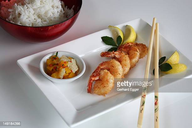 Coconut prawns with chopsticks