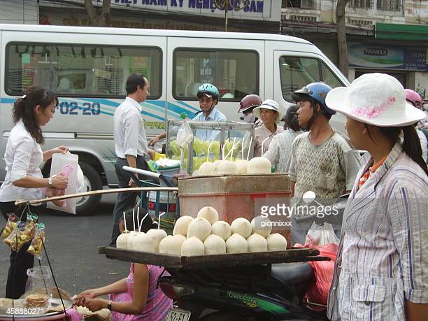 coconut seller, saigon vietnam - vietnamese cultuur stockfoto's en -beelden