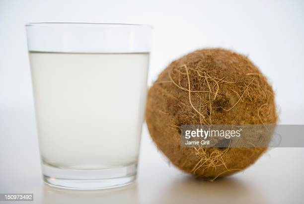 coconut water in glass - coconut water stock pictures, royalty-free photos & images