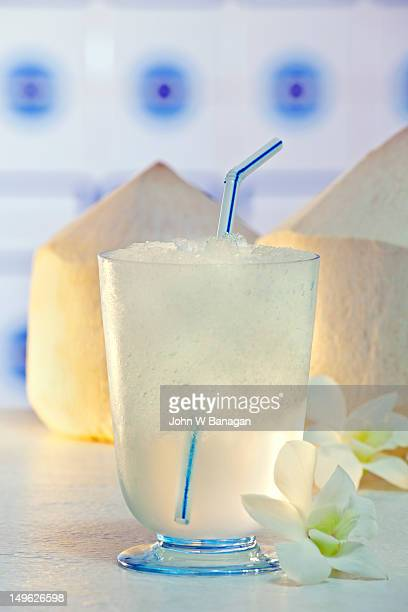 Coconut water in glass with ice