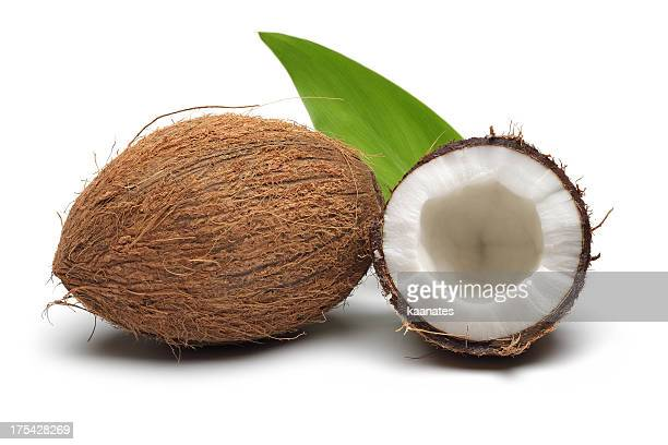 coconut with green leaves - coconut stock pictures, royalty-free photos & images