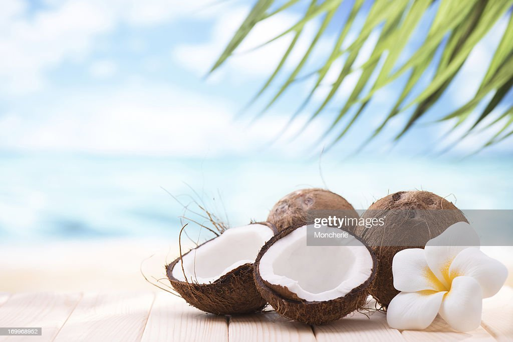 Coconuts on the beach with copy space : Stock Photo