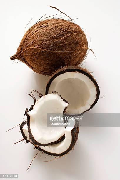 Coconuts, whole and cut open