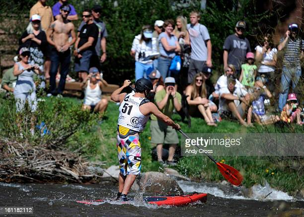 Corran Addison, from San Clemente California, negotiates the Gore River during the SUP Surf Sprint at the 10th annual Teva Mountain Games in Vail...