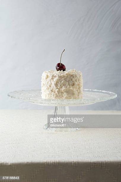 Cocos cherry cake with cocos butter cream on cake stand