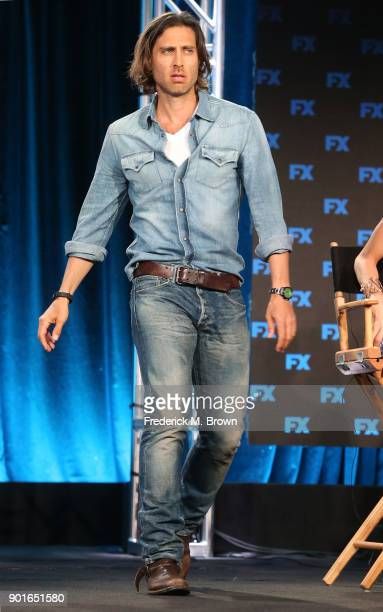 Cocreator/executive producer/writer Brad Falchuk of the television show POSE walks onstage during the FOX/FX Networks portion of the 2018 Winter...