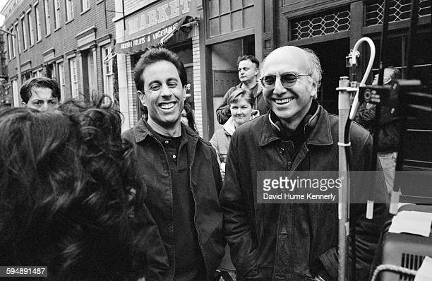 Cocreators Jerry Seinfeld and Larry David laugh while talking with actress Julia LouisDreyfus on set of the hit television show 'Seinfeld' during the...