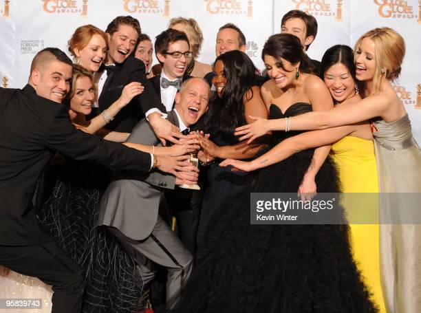"""Co-creator/writer Ryan Murphy poses in the press room with the cast of """"Glee"""" with the award for Best Television Series Musical or Comedy for """"Glee""""..."""