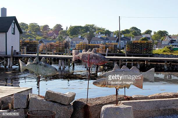 Cod fish weathervanes on waterfront Vinalhaven Island Maine New England USA