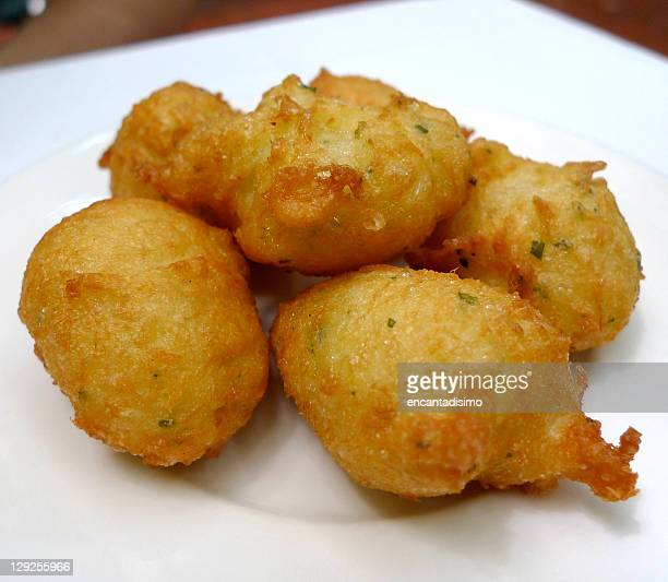 cod fritters - fritter stock photos and pictures