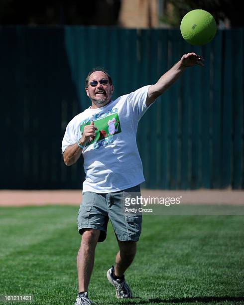 DENVER CODan Steffes McKaila's father throws the ball in from the outfield during the 3rd annual McKaila Ball a kickball party at the Colorado...